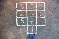 Closeup of hopscotch drawn with chalk on asphalt road. Children stock photos