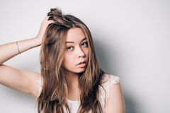 Closeup horizontal portrait of a beautiful attractive woman on white background with copy space. Young brunette girl with long hair looking at camera stock image