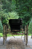 Closeup of horse drawn buggy on cobblestone Royalty Free Stock Images