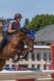 Closeup of horsewoman jumping. Vertically. Stock Photo