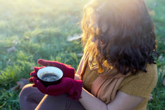 Closeup of hot coffee drink in female hands Stock Images