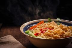 Closeup of hot noodles with smokes. Dark background Royalty Free Stock Photography