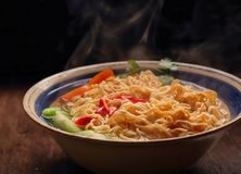 Closeup of hot noodles with smokes. Dark background Royalty Free Stock Image