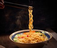 Closeup of hot noodles with smokes. Dark background Stock Photos