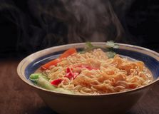 Closeup of hot noodles with smokes. Dark background Stock Photography