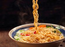 Closeup of hot noodles with smokes. Dark background Royalty Free Stock Photos