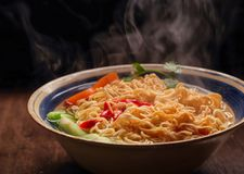 Closeup of hot noodles with smokes. Dark background Stock Photo