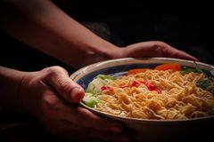 Closeup of hot noodles with smokes. Eating instant noodles is like smoking cigarettes Royalty Free Stock Image