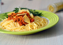 Closeup of hot spaghetti bolognese served with ruccola Royalty Free Stock Image