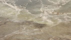 Closeup of hot water flowing over calcium travertines with steam in Pamukkale, Turkey. 4k stock footage