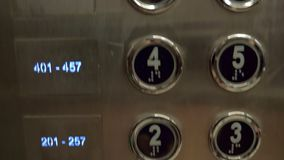 A closeup of hotel elevator buttons stock video footage