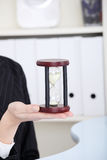 Closeup on hourglass. Closeup on hourglass in caucasian woman`s hand Stock Photography