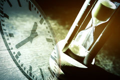 Closeup hourglass on black background Royalty Free Stock Photo
