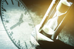 Closeup hourglass on black background Royalty Free Stock Images
