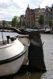 Closeup of house boat on the Amstel in Amsterdam. The rudder of a houseboat parked in the Amstel river, Amsterdam, The Netherlands Royalty Free Stock Photos