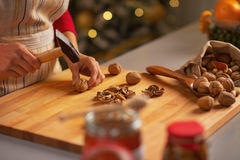 Closeup on housewife chopping walnuts Royalty Free Stock Images
