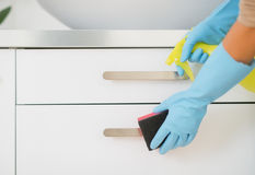 Closeup on housewife cleaning in bathroom Royalty Free Stock Photos