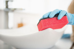 Closeup on housewife cleaning sink with sponge Stock Photos