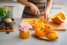 Closeup on housewife cutting pumpkin for pickling Royalty Free Stock Image