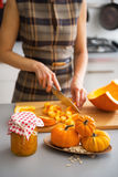 Closeup on housewife cutting pumpkin for pickling Stock Photo