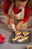 Closeup on housewife making christmas cookies Stock Photos