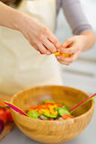 Closeup on housewife preparing vegetable salad Royalty Free Stock Photos