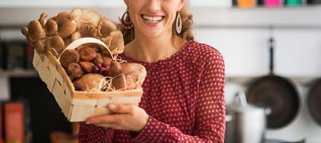 Closeup on housewife showing basket with mushrooms Stock Photography