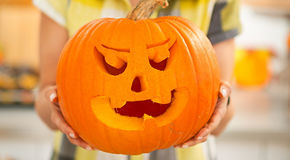 Closeup on housewife showing big pumpkin Jack-O-Lantern Royalty Free Stock Image