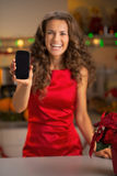 Closeup on housewife showing cell phone in kitchen Royalty Free Stock Photo