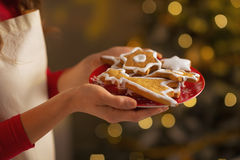 Closeup on housewife showing christmas cookies Stock Photo