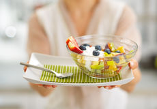 Closeup on housewife showing fresh fruit salad Royalty Free Stock Photo