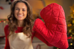 Closeup on housewife showing red kitchen gloves Royalty Free Stock Photography