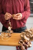 Closeup on housewife stringing mushrooms on string Royalty Free Stock Images