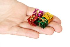 Closeup of human hand holding little gifts Royalty Free Stock Photo