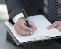 Businessman signs a contract. Holding pen in hand. Stock Photography