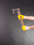 Closeup human hands holding axe chopper. Royalty Free Stock Images