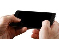 Closeup human hands holding smartphone Stock Images
