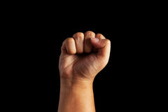 Closeup of human male hand. Raised up clenched fist, on white background Stock Photos
