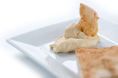 Closeup of hummus with pita isolated against white Stock Images