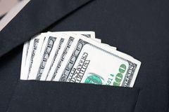 Closeup of hundred dollar bills in suit pocket. Background Stock Photos
