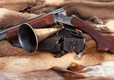 Closeup of hunter gun on fur background. Hunting subjects on background of the fur Royalty Free Stock Images