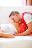 Closeup on husband kissing pregnant wifes tummy Royalty Free Stock Photos