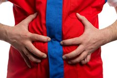 Closeup of hypermarket employee touching stomach royalty free stock photos