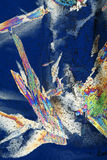 Closeup of Ice Crystals. An abstract image close up of Ice Crystals.  By light with polarized light it shows a rainbow spectrum of colors Stock Photo