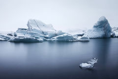Closeup of Icebergs Floating in Jökulsárlón. Blue and grey water/icebergs in Iceland Stock Photos