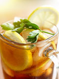 Closeup iced tea with lemon slice and leaf garnish Royalty Free Stock Photo