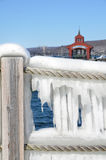 Closeup of icy rope barrier in the harbor of Seneca Lake. Showing the Seneca Lake dock after winter storm Stella. One of the Finger Lakes of New York State. At royalty free stock photo