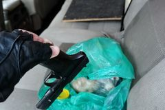 Illegal firearm found in a ca. Closeup of a illegal firearm found in a car among of personal effects stock photography