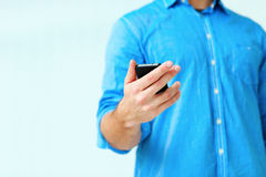 Closeup image af a man holding smartphone Royalty Free Stock Image