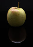 Closeup image of apple on black background with reflection Stock Image